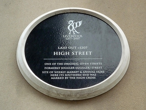 Black plaque marking the location of High Street, Liverpool, one of the original seven streets of the town