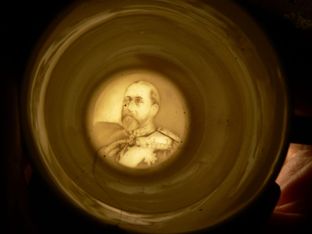 Photograph of translucent image of Edward VII in base of teacup
