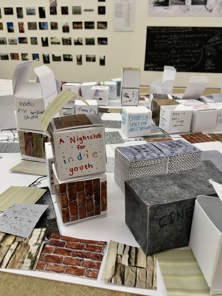Photograph of cardboard cubes making houses and urban features