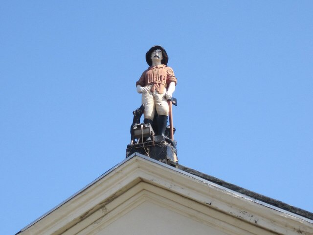 Photograph of the lumberjack statue on top of the former Dominion pub, Liverpool